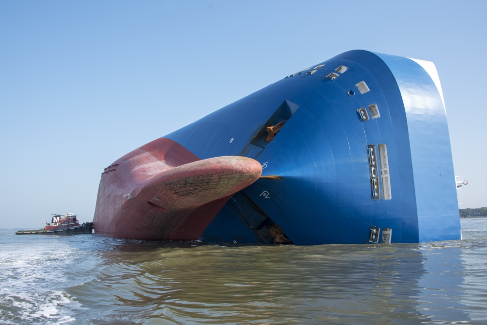 A large freighter vessel on its side.