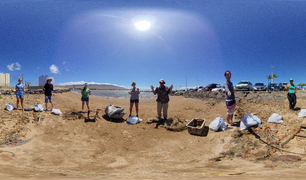 People on a beach with debris.