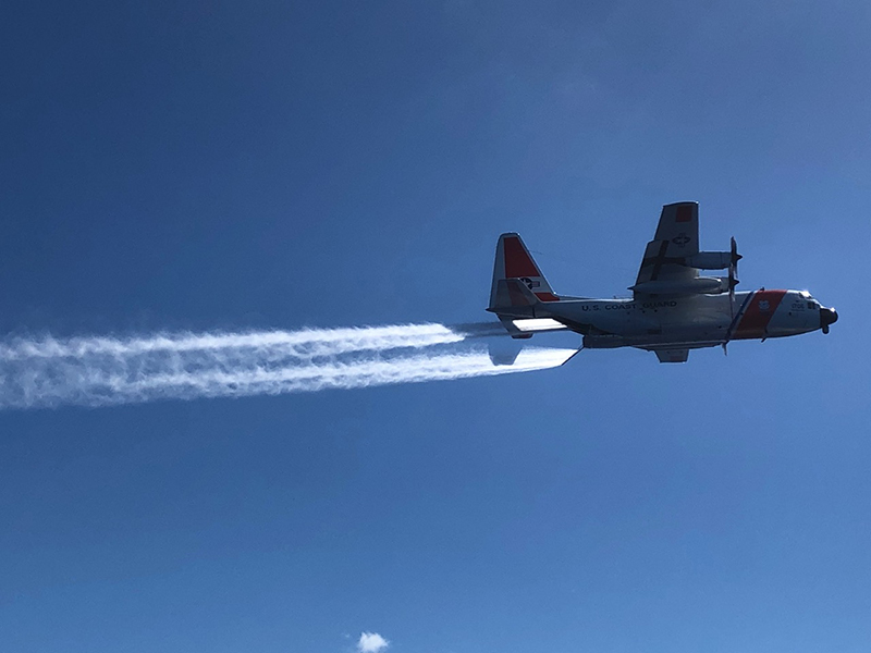 Plane flying over the surface, spraying water