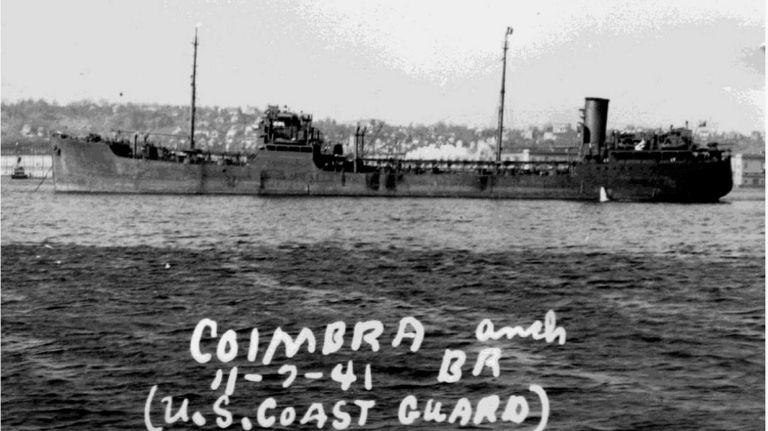 "A black and white photo of a tanker with the text ""Coimbra, 11-7-41, U.S. Coast Guard"" written on it."