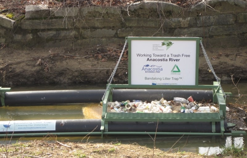 Example of a floating trash boom installed on a river.