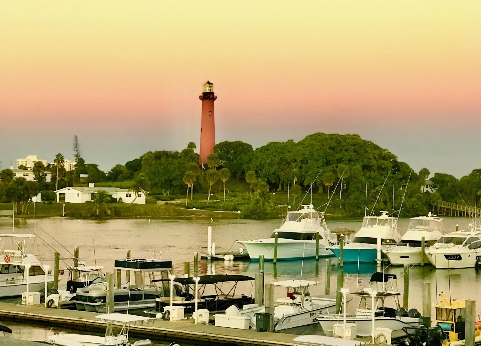 A marina with a lighthouse.