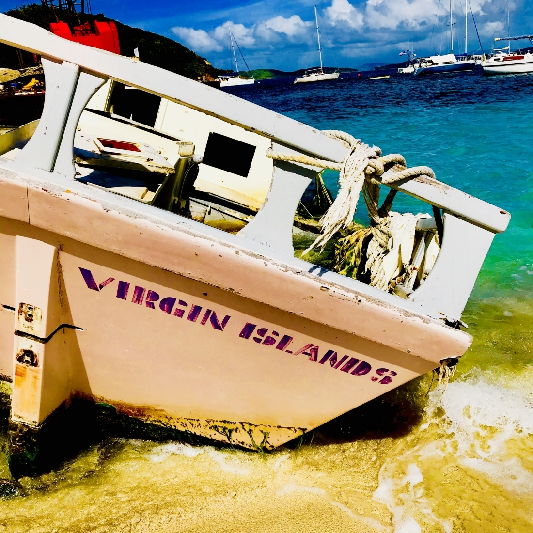 "A beached vessel with the text ""Virgin Islands"" on the back."