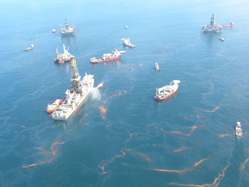 A view of response ships at the source of the Deepwater Horizon oil spill in the Gulf of Mexico, a month after the rig exploded and sank, tragically claiming the lives of 11 people. (NOAA)