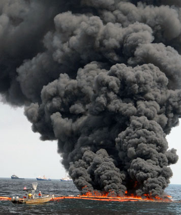 A controlled in-situ burn of surface oil after the 2010 Deepwater Horizon/BP spill in the Gulf of Mexico. (USCG)