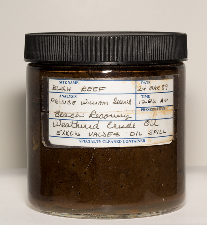 A jar of oil from the Exxon Valdez oil spill labeled with general information about the spill.