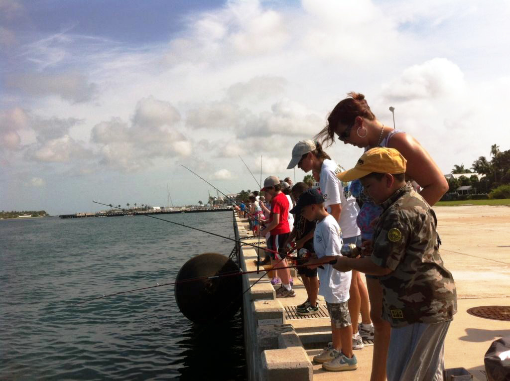 People fishing off a pier.