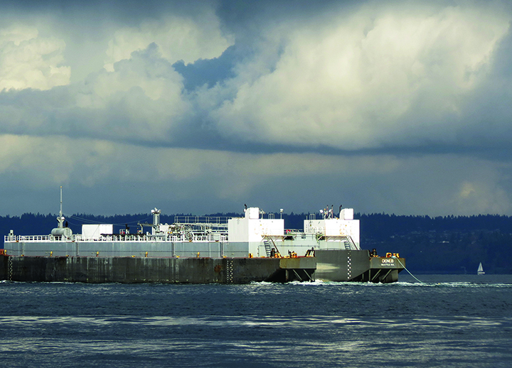 A fuel barge in Puget Sound on a cloudy day.