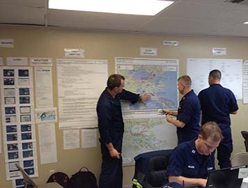 NOAA's Lieutenant (junior grade) Kyle Jellison describing the location of oil spill sites to the U.S. Coast Guard Situation Unit inside the Hurricane Isaac command post in New Orleans, La.