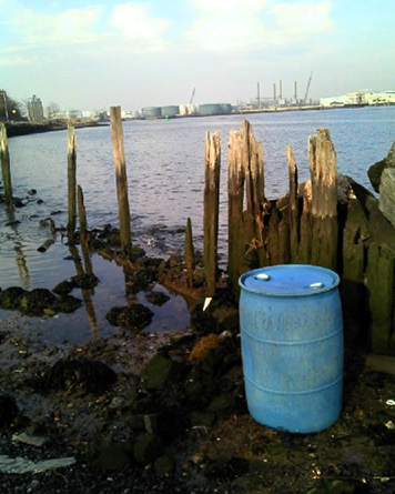 Blue drum at water's edge after Sandy in New York.