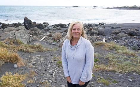 A woman on a beach.