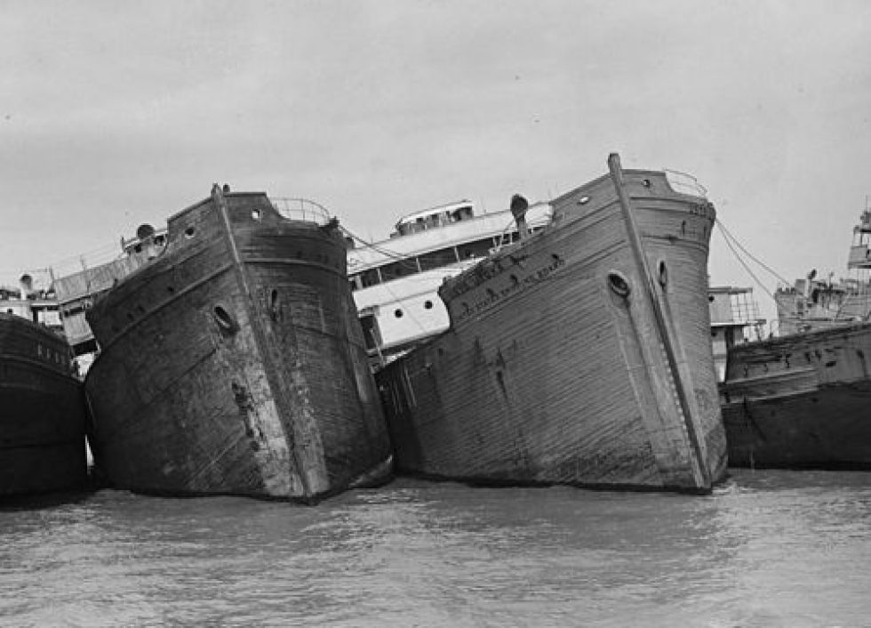 Old image of ships in a row, listing.