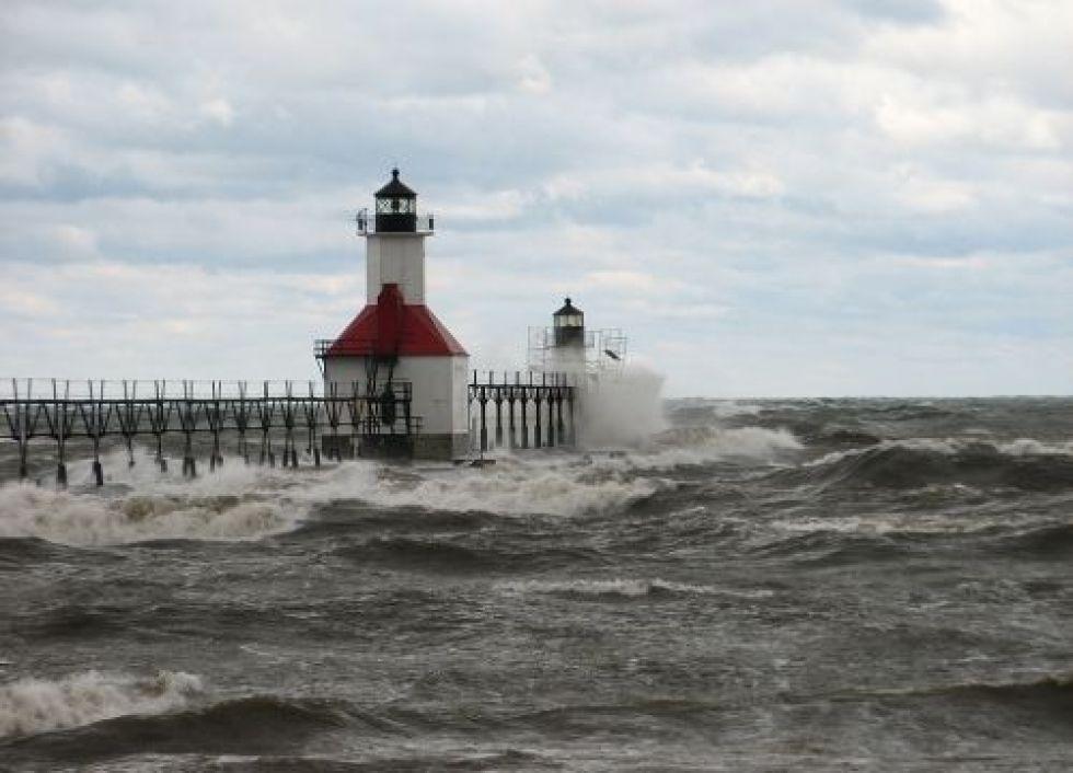 Ocean waves hitting lighthouse.