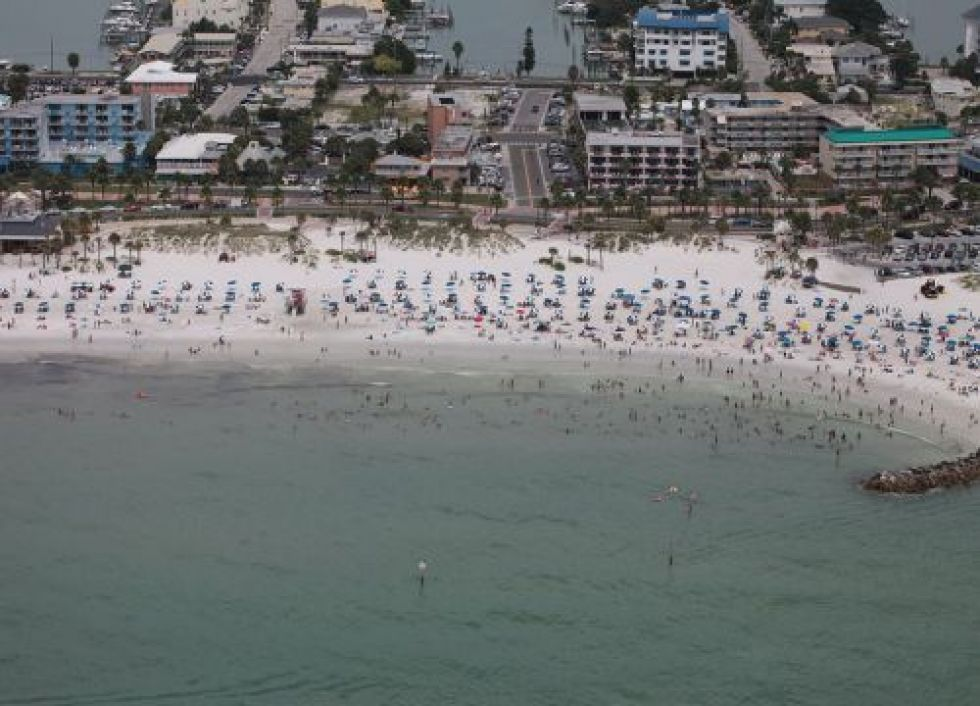 Beach with people and buildings. Image credit: NOAA.