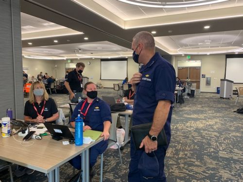 A group of people in an incident command center.