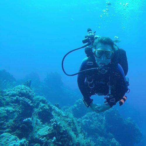A woman scuba diving.