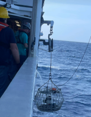 A camera being picked up by a ship.