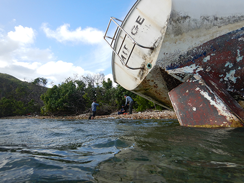 Beached vessel on its side.