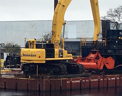 Heavy equipment at water's edge.