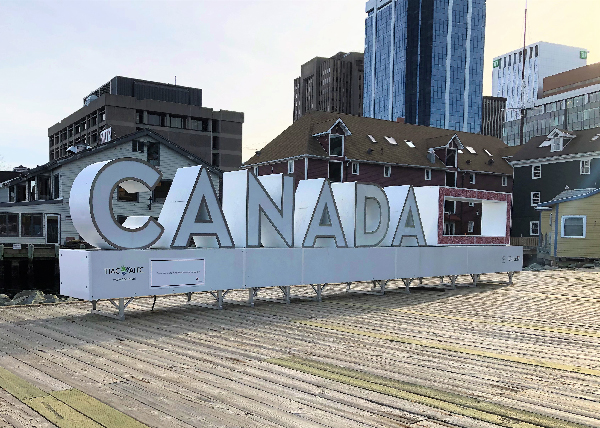 "Letters that spell ""Canada"" outdoors."