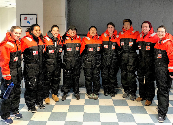 Group posing for photo in uniforms.