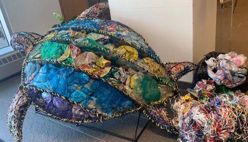 Turtle sculpture made of marine debris.