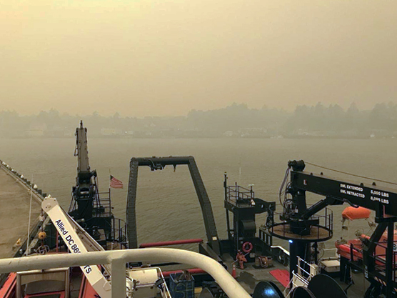 View of a hazy skyline from a vessel.