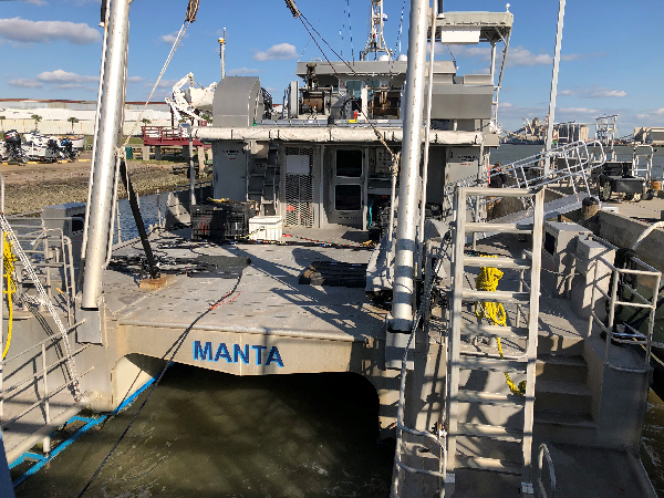 Marine vessel at a dock.