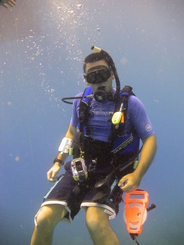 A man underwater in diving gear.