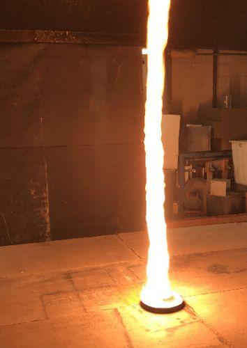 A vertical stream of fire.