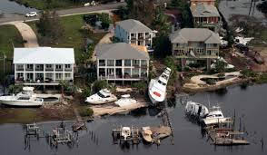 Overhead view of houses on the water, docks and boats.