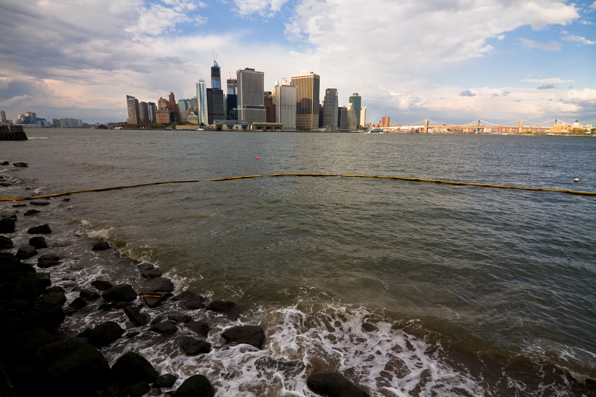 A city skyline as seen from across the water.