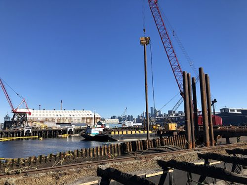Dock with industrial scene in the background.