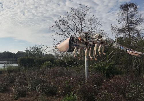 Photo taken outdoors of large shrimp sculpture.