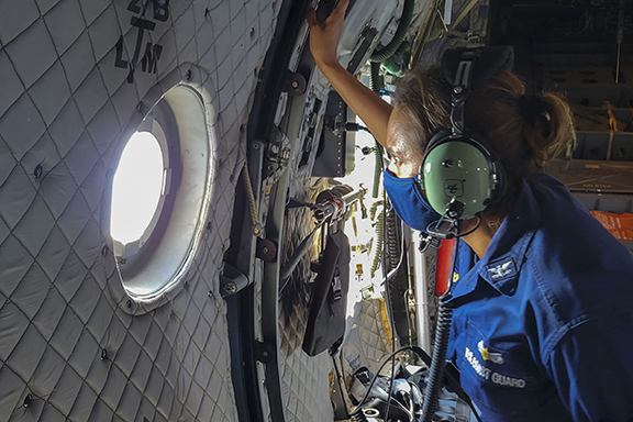 Woman looking out the window of a plane.
