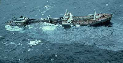 A large ship sinking in the ocean.