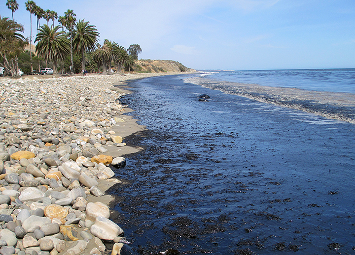Oil covering a rocky beach.