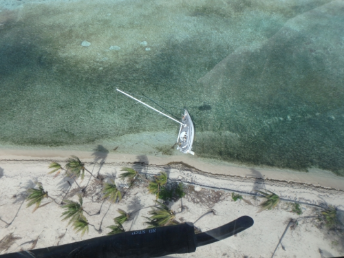 An aerial image of a grounded vessel on a beach.