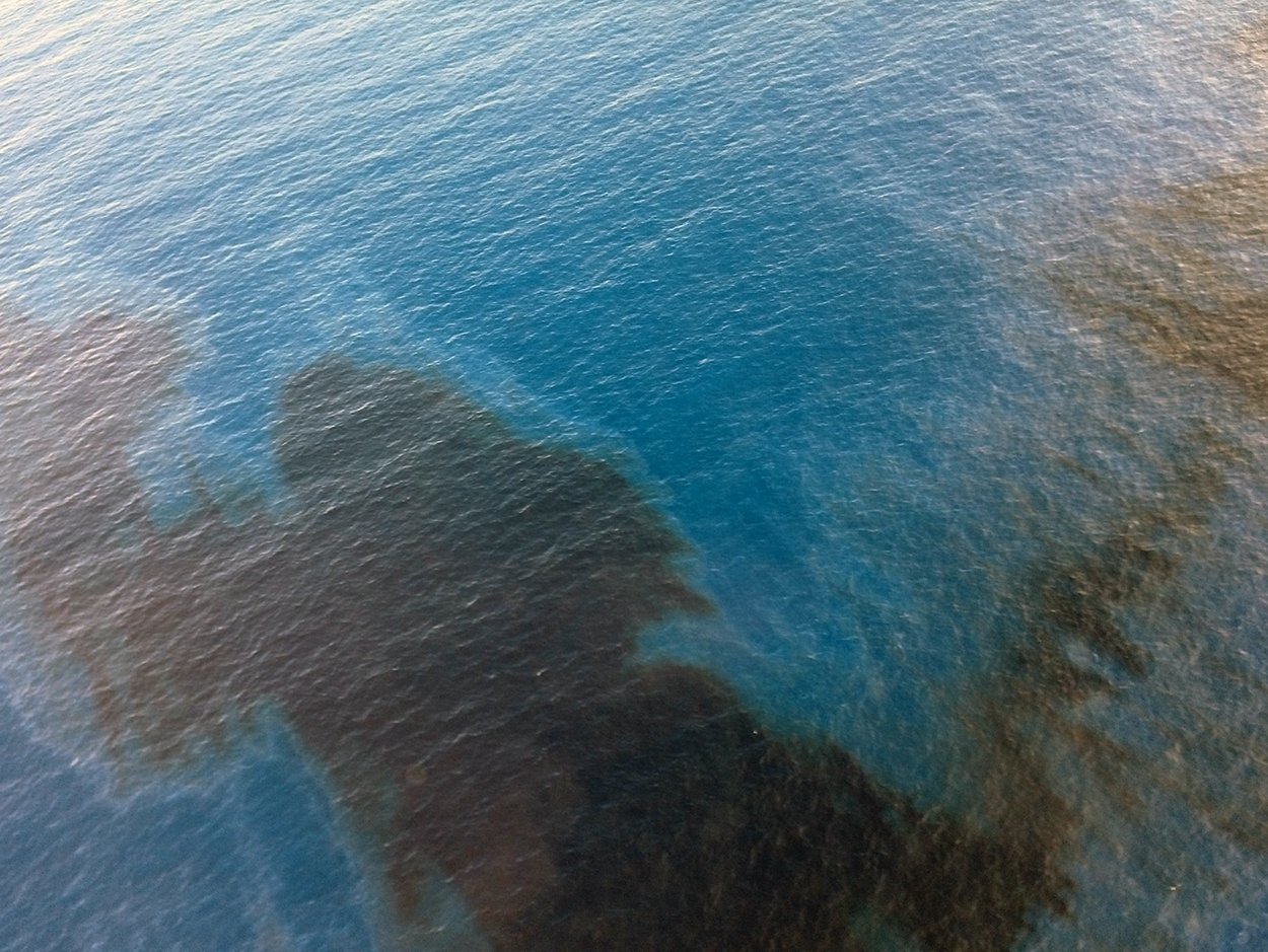 Aerial view of oil slick on water.