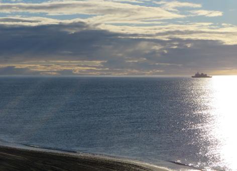 Ship on the horizon of the ocean.
