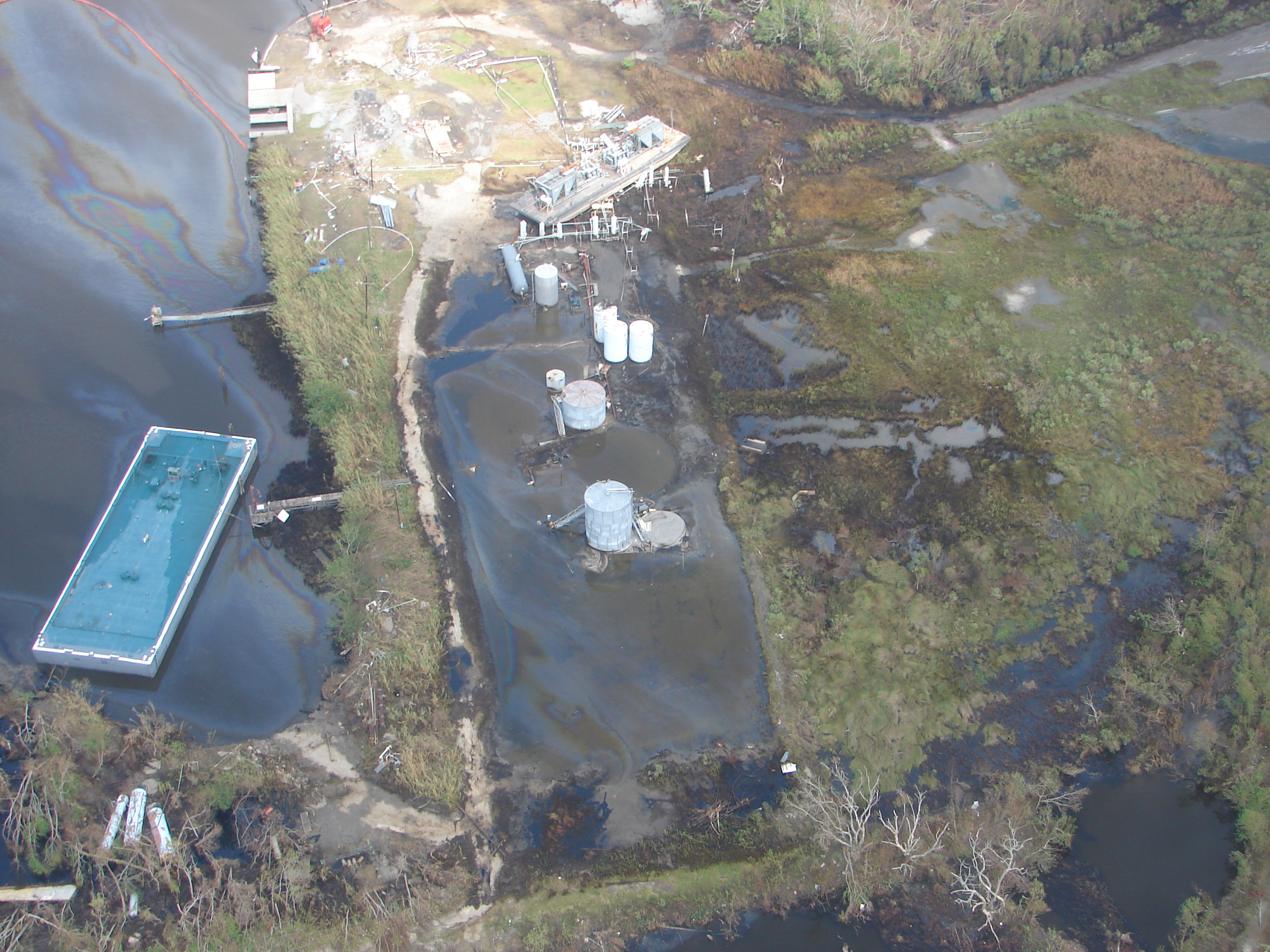 Aerial view of damaged energy facility.