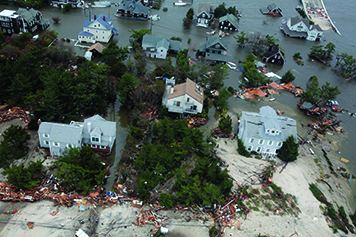 Aerial view of damaged homes on the coast.