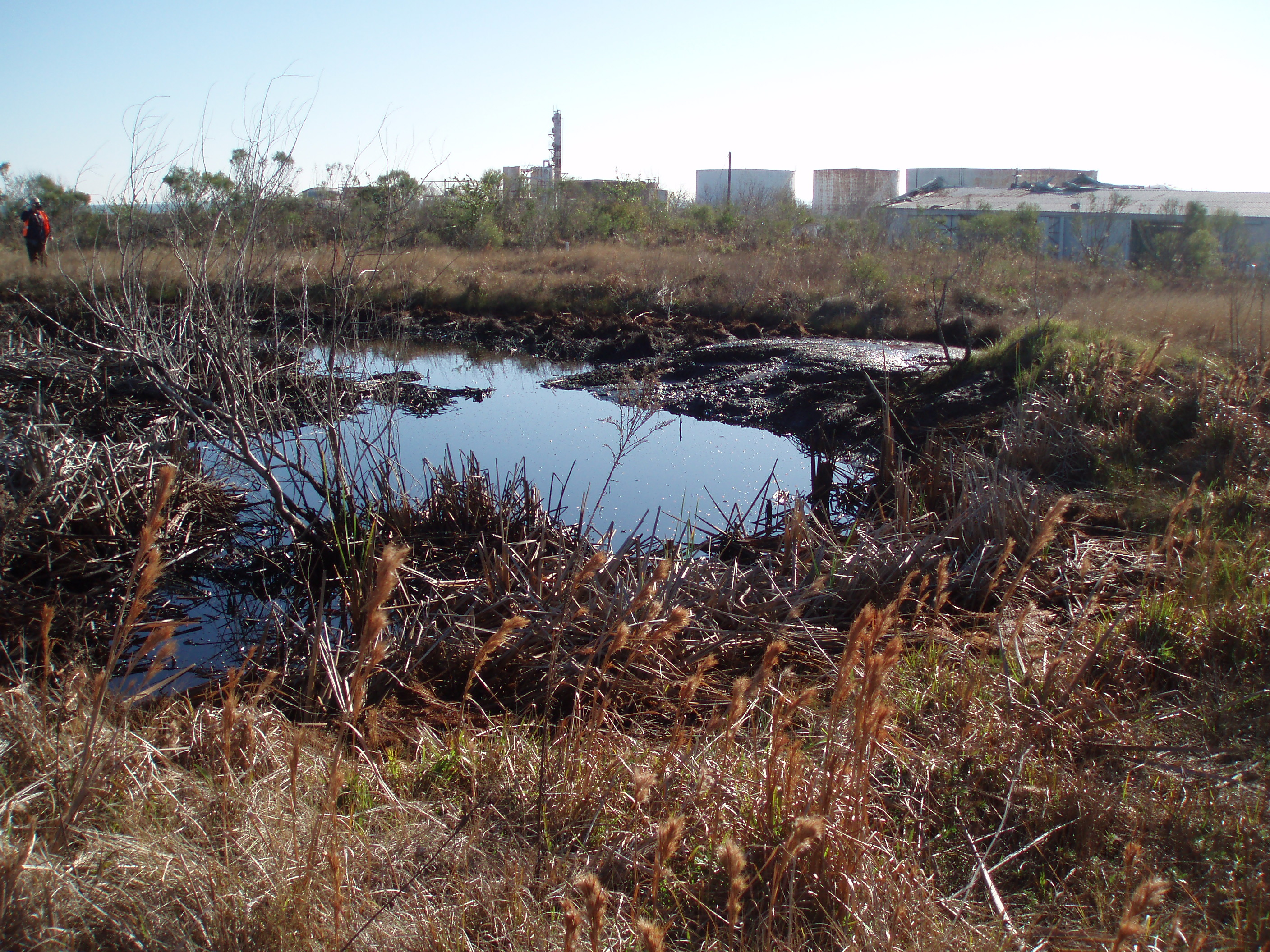 Image of oil pits left over from chemical and oil processing from 1964 to 1996.