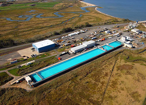 Aerial view of testing facility with long pool.