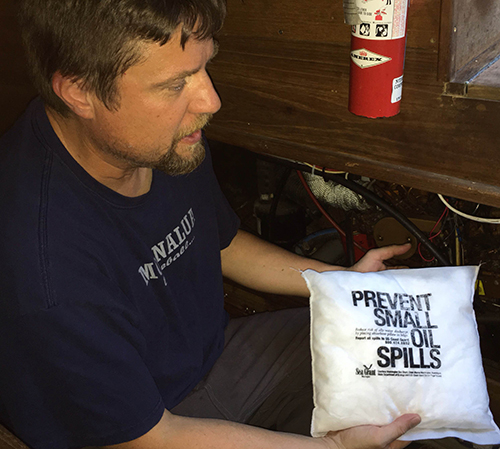Man with spill prevention kit.