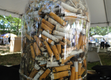 Jar of cigarette butts.