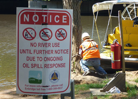 Posted sign closing river activity due to oil spill response.