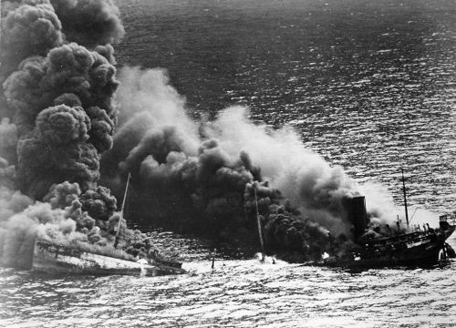 Smoke rises from a sinking tanker in the Atlantic Ocean.
