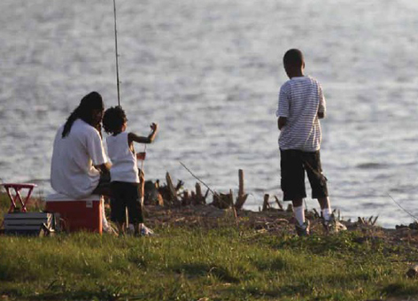A family fishes on the Anacostia River near Washington, D.C.
