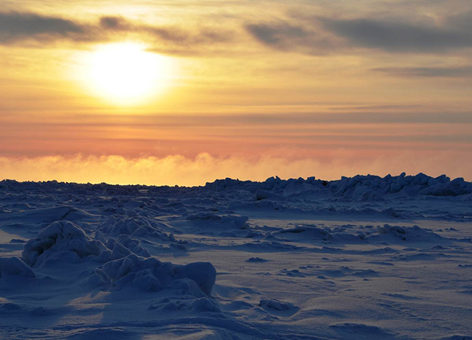 The snowy horizon outside Barrow, Alaska, at sunset.